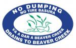 No dumping, drains to Beaver Creek; No tire basura, va a dar a Beaver Creek