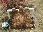 Tube apparatus in the ground used to prevent residential backflow